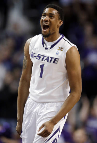 Kansas State guard Shane Southwell celebrates a 3-point basket during the first half of an NCAA college basketball game against Baylor in Manhattan, Kan., Saturday, Feb. 16, 2013. (AP Photo/Orlin Wagner)