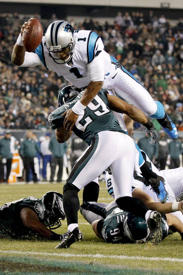 Carolina Panthers quarterback Cam Newton (1) hurdles Philadelphia Eagles strong safety Nate Allen (29) to score a touchdown in the second half of an NFL football game, Monday, Nov. 26, 2012, in Philadelphia. (AP Photo/Mel Evans)