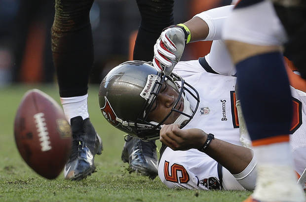 Tampa Bay Buccaneers quarterback Josh Freeman (5) hits the ground after being sacked by the Denver Broncos in the third quarter of an NFL football game, Sunday, Dec. 2, 2012, in Denver. (AP Photo/Joe Mahoney)