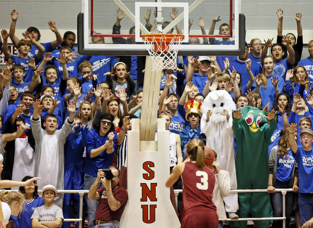 Mount St. Mary fans try to distract Byng's Alexis Hill (3) as she attempts a foul shot during a Class 4A girls high school basketball game in the first round of the state tournament at the Sawyer Center on the campus of Southern Nazarene University in Bethany, Okla., Thursday, March 7, 2013. Photo by Nate Billings, The Oklahoman