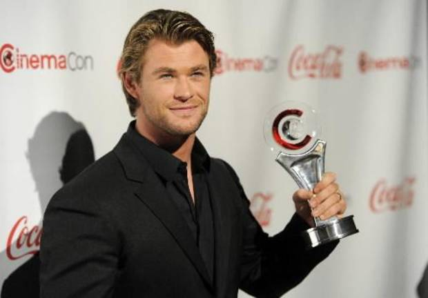 Actor Chris Hemsworth, recipient of the Male Star of Tomorrow award, poses for photographers at the CinemaCon Big Screen Achievement Awards, Thursday, March 31, 2011, in Las Vegas. (AP Photo/ Chris Pizzello)