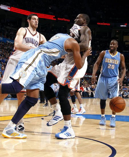 Denver's Nene (31) pushes Oklahoma City's Kendrick Perkins (5) during the NBA basketball game between the Oklahoma City Thunder and the Denver Nuggets, Friday, April 8, 2011, at the Oklahoma City Arena.. Photo by Sarah Phipps, The Oklahoman