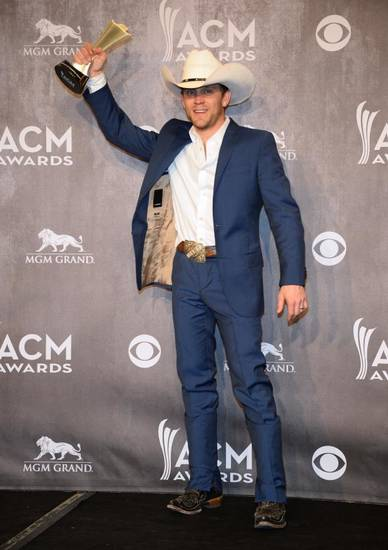 Justin Moore poses in the press room with the new artist of the year award at the 49th annual Academy of Country Music Awards at the MGM Grand Garden Arena on Sunday, April 6, 2014, in Las Vegas. (AP)