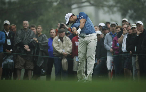 Jason Day, of Australia, tees off on the 18th hole during a practice round for the Masters golf tournament Monday, April 7, 2014, in Augusta, Ga. (AP Photo/Charlie Riedel)
