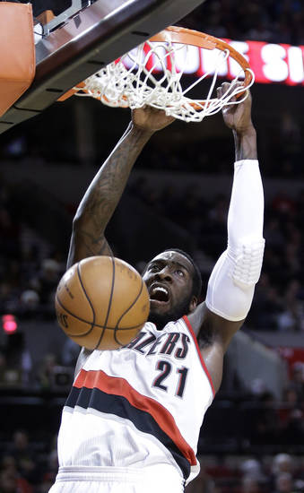 Portland Trail Blazers center J.J. Hickson scores during the second half of an NBA basketball game against the Phoenix Suns in Portland, Ore., Tuesday, Feb. 19, 2013.  Hickson scored 25 points, pulled in 16 rebounds and had seven assists while Phoenix beat Portland 102-98.(AP Photo/Don Ryan)