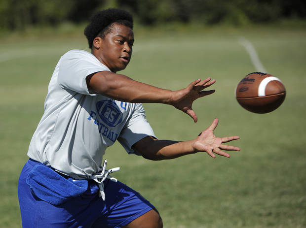 COLLEGE FOOTBALL: Jesse Vester catches a football during a practice at Northeastern Oklahoma A&M College in Miami, Okla., Wednesday, July 18, 2012.  Photo by Garett Fisbeck, The Oklahoman