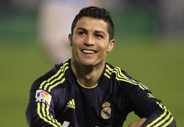 Real Madrid's Cristiano Ronaldo from Portugal reacts  during the 1st leg of a last-16 Copa del Rey soccer match against Celta at the Balaídos stadium in Vigo, Spain, Wednesday Dec. 12, 2012. Celta won the match 2-1. (AP Photo/Lalo R. Villar)