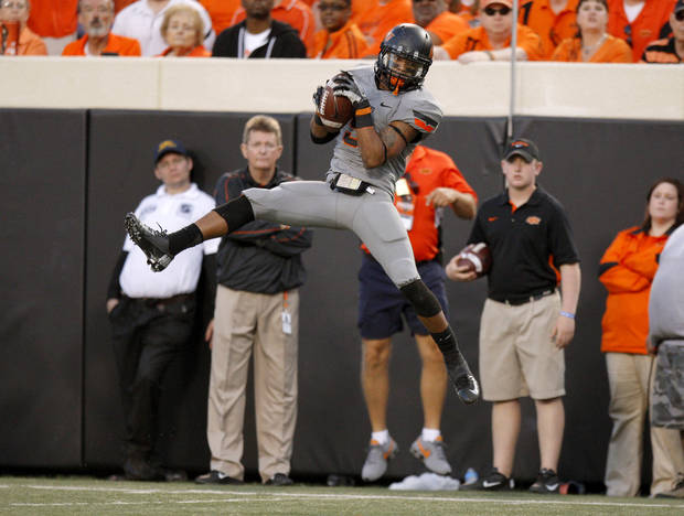 Oklahoma State&#039;s Josh Stewart (5) catches a pass during a college football game between Oklahoma State University (OSU) and West Virginia University at Boone Pickens Stadium in Stillwater, Okla., Saturday, Nov. 10, 2012. Oklahoma State won 55-34. Photo by Bryan Terry, The Oklahoman