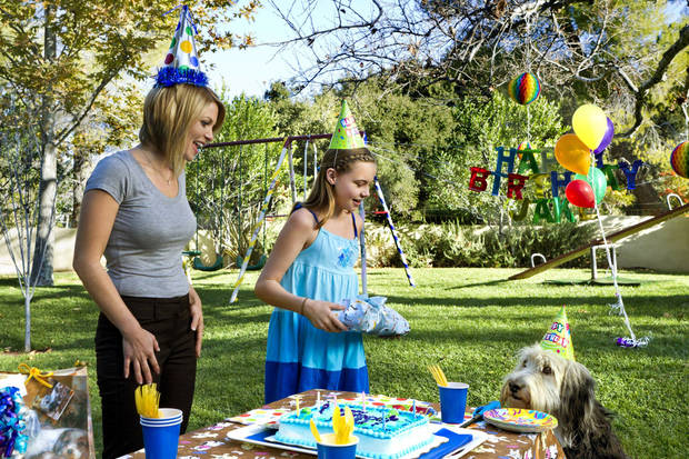 When single mom Megan (Candace Cameron Bure) and her daughter Caitlin (Katie Hawkins) adopt a lovable pound puppy (Bug Z) from a shelter, they waste no time making him a permanent part of the family! Photo:  Copyright 2012 Crown Media Holdings, Inc./Photographer Alexx Henry