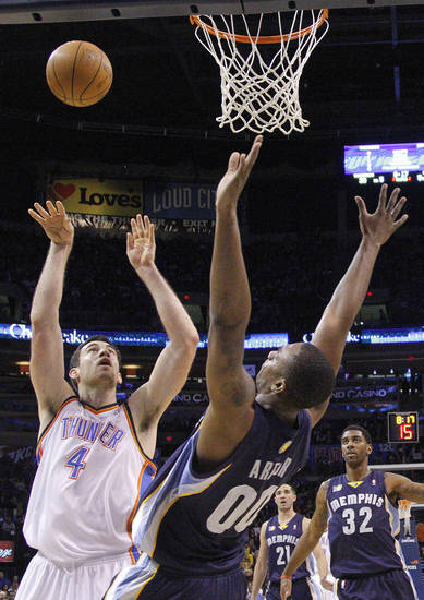 Oklahoma City's Nick Collison (4) shoots over Memphis' Darrell Arthur (00) during the NBA basketball game between the Oklahoma City Thunder and the Memphis Grizzlies, Saturday, Jan. 8, 2011, at the Oklahoma City Arena. Photo by Sarah Phipps, The Oklahoman