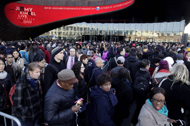 Commuters wait in a line to board busses into Manhattan in front of the Barclays Center in Brooklyn, New York, Thursday, Nov. 1, 2012.  The line stretched twice around the arena and commuters reported wait times of one to three hours to get on a bus. (AP Photo/Seth Wenig) ORG XMIT: NYSW104