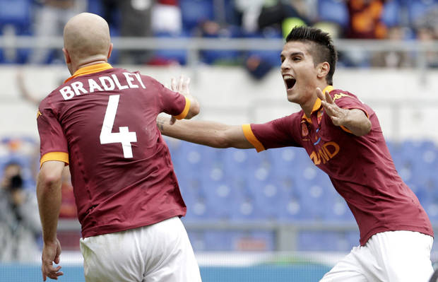 AS Roma midfielder Michael Bradley, of the United States, left, celebrates with teammate Erik Lamela, of Argentina, after scoring during a Serie A soccer match between AS Roma and Atalanta, at Rome's Olympic stadium, Sunday, Oct. 7, 2012. (AP Photo/Riccardo De Luca)