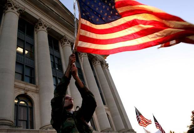 Michael Meyers, of Norman, waves a flag during a rally on the north side of the Oklahoma State Capitol in Oklahoma CIty on Wednesday, Nov. 4, 2009. By John Clanton, The Oklahoman  ORG XMIT: KOD