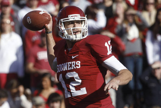 Oklahoma quarterback Landry Jones throws against Oklahoma State in the first quarter of an NCAA college football game in Norman, Okla., Saturday, Nov. 24, 2012. (AP Photo/Sue Ogrocki)