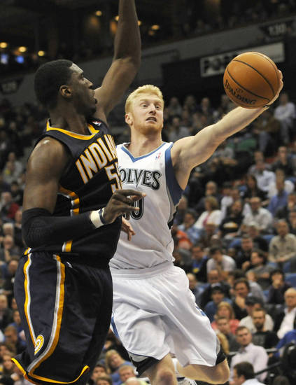 Minnesota Timberwolves' Chase Budinger prepares to pass as Indiana Pacers' Roy Hibbert defends in the second half of an NBA basketball game Friday, Nov. 9, 2012, in Minneapolis. The Timberwolves won 96-94. Budinger led the Timberwolves with 18 points. (AP Photo/Jim Mone)