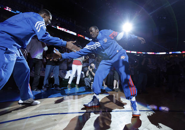 Oklahoma City's Thabo Sefolosha and Serge Ibaka do their pre-game routine during Game 2 in the second round of the NBA playoffs between the Oklahoma City Thunder and the L.A. Lakers at Chesapeake Energy Arena on Wednesday,  May 16, 2012, in Oklahoma City, Oklahoma. Photo by Chris Landsberger, The Oklahoman