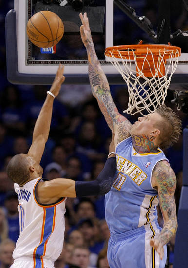 Denver's Chris Andersen (11) blocks a shot by Oklahoma City's Russell Westbrook (0) during the first round NBA playoff game between the Oklahoma City Thunder and the Denver Nuggets on Sunday, April 17, 2011, in Oklahoma City, Okla. Photo by Chris Landsberger, The Oklahoman