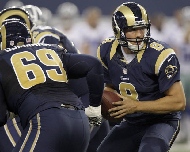 St. Louis Rams quarterback Sam Bradford (8) looks to hand the ball off against the Dallas Cowboys during the first half of a preseason NFL football game, Saturday, Aug. 25, 2012 in Arlington, Texas. (AP Photo/LM Otero)  ORG XMIT: CBS129