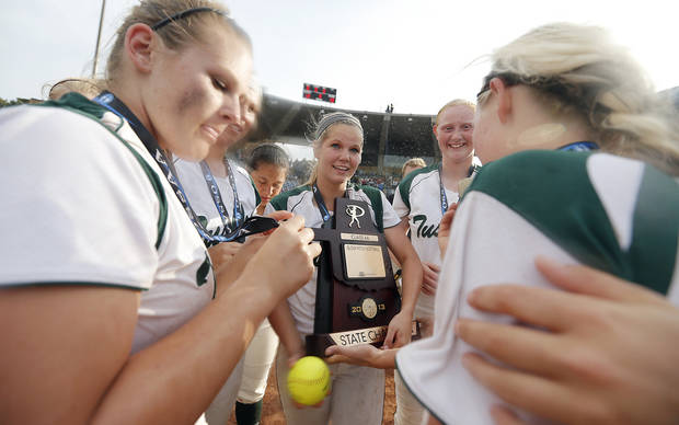 Tushka pitcher Haley Cops holds the championship trophy after the win over Dale in the Class 4A Oklahoma State High School Slow Pitch Softball Championship at ASA Hall of Fame Stadium in Oklahoma City, Wednesday, May 1, 2013. Photo by Chris Landsberger, The Oklahoman