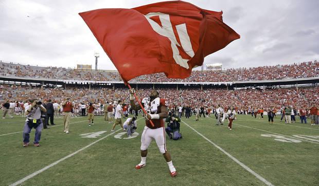 OU&#039;s Jamarkus McFarland (97) waves the OU flag after the Sooners&#039; 63-21 win over Texas during the Red River Rivalry college football game between the University of Oklahoma (OU) and the University of Texas (UT) at the Cotton Bowl in Dallas, Saturday, Oct. 13, 2012. Photo by Chris Landsberger, The Oklahoman