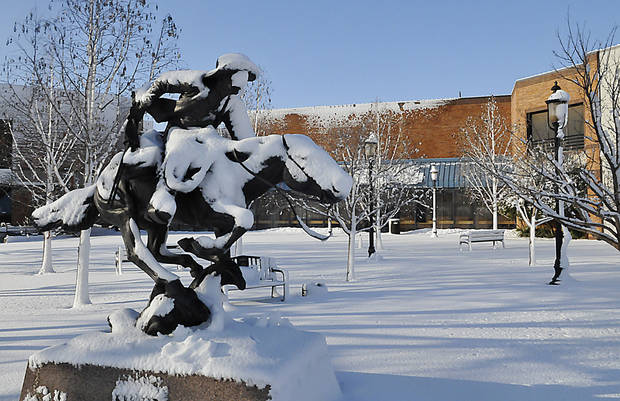 The Harold T. Holden statue &quot;Boomer&quot; is covered in snow at Centennial Plaza Tuesday, Feb. 26, 2013 in Enid, Oklahoma. The city received an estimated 10 inches of snow and wind damage leaving 90 per cent of the town without power. (AP Photo/Enid News &amp; Eagle, Billy Hefton)  ORG XMIT: OKENI105