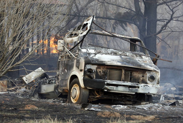 A burned out motor home was in the path of wildfires which destroyed 12 structures in Lindsay, Okla., on Thursday, April 9, 2009. Photo by Steve Sisney, The Oklahoman