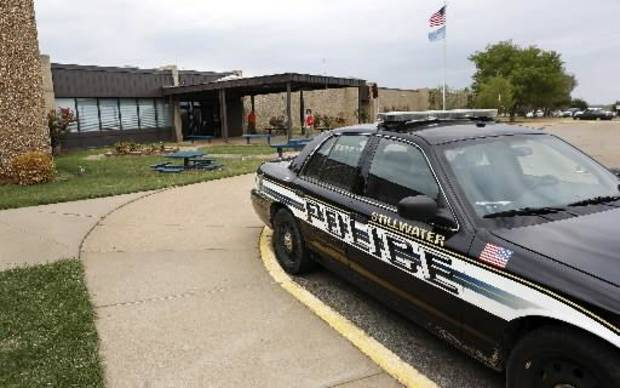Stillwater police in front of Stillwater Junior High School, where student Cade Poulos, 13, died this morning, Wednesday, Sep. 26, 2012, from a self-inflicted gunshot wound to the head. Photo by Jim Beckel, The Oklahoman.