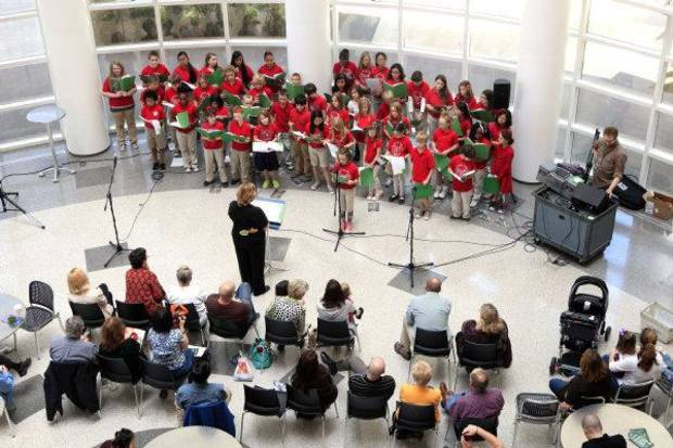 The Cleveland Choraleers from Cleveland Elementary School perform during Noon Tunes at the downtown library in Oklahoma City. Noon Tunes performances are free and happen every Thursday. <strong>PAUL B. SOUTHERLAND - THE OKLAHOMAN</strong>