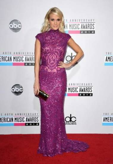 Carrie Underwood walks the AMA red carpet.