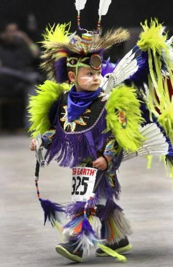 Corbyn Swift, 3, of Lawton, was one of the youngest dancers to perform at the 2012 Red Earth Festival inside the Cox Convention Center on Saturday, June 9, 2012. He was there with his dad, Frank, and other members of his family. They are members of the Wichita/Comanche Tribe. Photo by Jim Beckel, The Oklahoman Archive