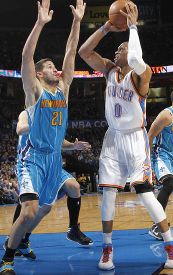 New Orleans Hornets' Greivis Vasquez (21) defends on Oklahoma City Thunder's Russell Westbrook (0) during the NBA basketball game between the Oklahoma CIty Thunder and the New Orleans Hornets at the Chesapeake Energy Arena on Wednesday, Dec. 12, 2012, in Oklahoma City, Okla.   Photo by Chris Landsberger, The Oklahoman