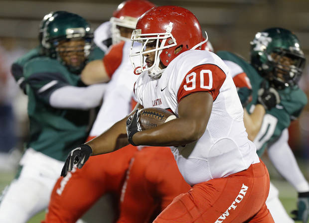 Lawton's Ivan Thomas runs against Edmond Santa Fe during a high school football game at Wantland Stadium in Edmond, Okla., Thursday, October 11, 2012. Photo by Bryan Terry, The Oklahoman