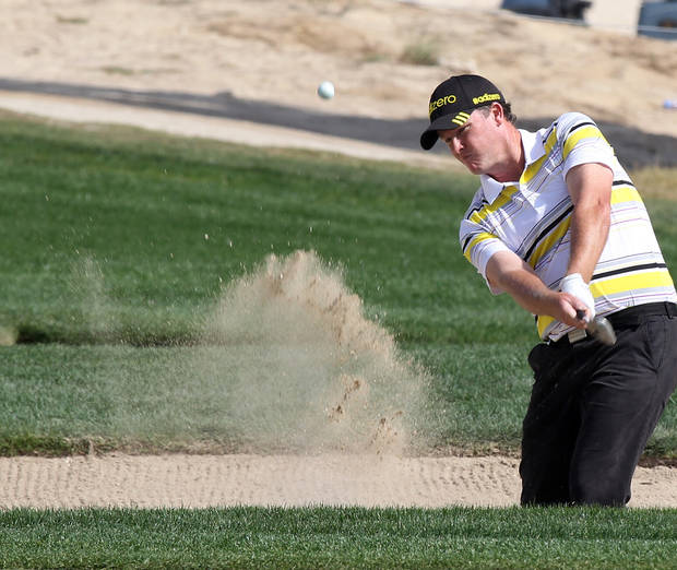 Marcus Fraser of Australia plays his shot on the 18 hole during the Second  round of the Commercial Bank Qatar Masters held at the Doha Golf Club in Qatar,Thursday, Jan. 24, 2013. (AP Photo/Osama Faisal)