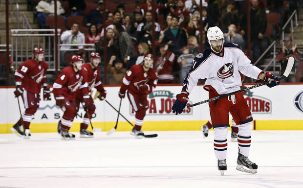 Columbus Blue Jackets' Nick Foligno, right, skates away as the Phoenix Coyotes celebrate a goal by Steve Sullivan during the second period in an NHL hockey game, Wednesday, Jan. 23, 2013, in Glendale, Ariz. (AP Photo/Ross D. Franklin)