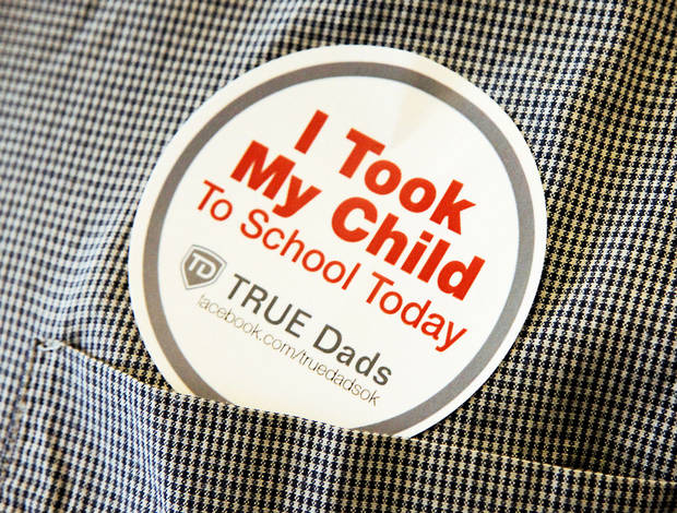 Sticker for Take Your Child to School Day, Friday, September 21, 2001.   Six Oklahoma City Public Schools will be part of the inaugural event. Photo By David McDaniel/The Oklahoman