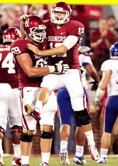 Landry Jones, right, celebrates a touchdown throw with Lane Johnson during the second half of OU's Oct. 20 victory over Kansas. Jones and Johnson competed in the Senior Bowl on Saturday. Photo by Steve Sisney, The Oklahoman