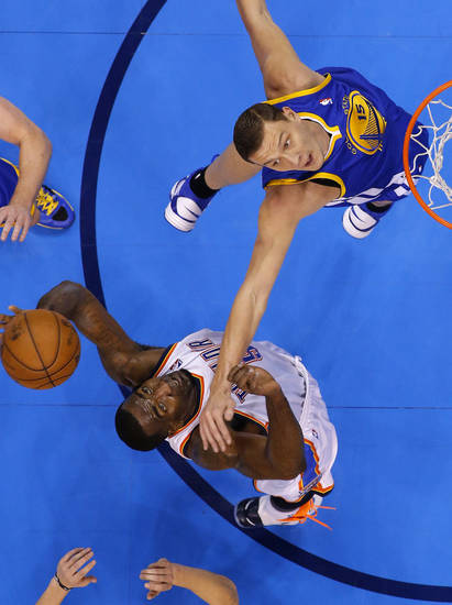 Oklahoma City's Kendrick Perkins (5) grabs the ball beside Golden State's Andris Biedrins (15) during an NBA basketball game between the Oklahoma City Thunder and the Golden State Warriors at Chesapeake Energy Arena in Oklahoma City, Wednesday, Feb. 6, 2013. Photo by Bryan Terry, The Oklahoman