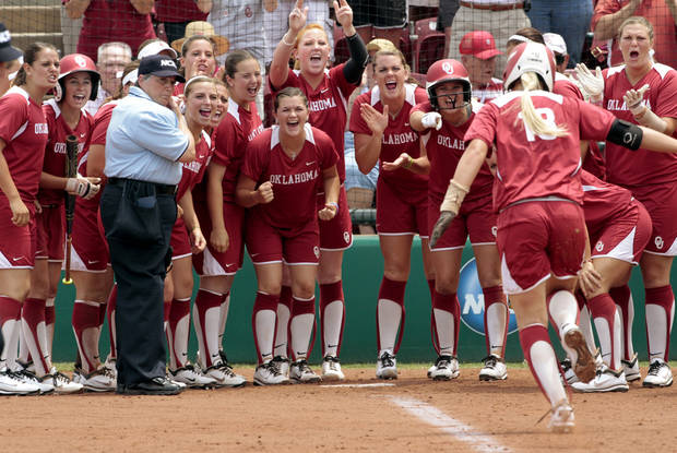 Sooner's celebrate catcher Jessica Shults home run in the fifth inning as the University of Oklahoma Sooner Softball team plays Arizona in game two of the NCAA Softball Norman Super Regional at Marita Hines field on Saturday, May 26, 2012, in Norman, Okla.  Photo by Steve Sisney, The Oklahoman