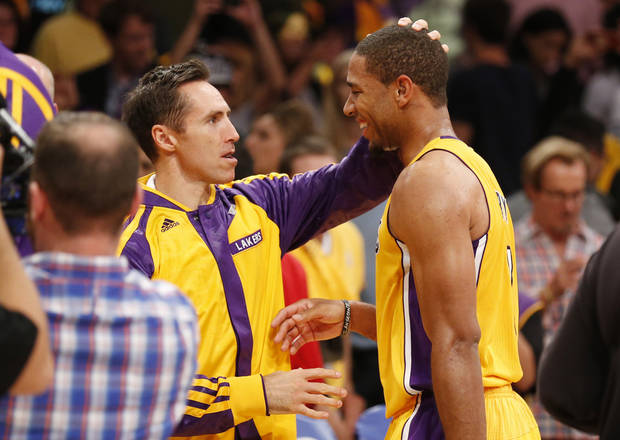 Los Angeles Lakers' Xavier Henry, right, is congratulated by Steve Nash after the Lakers defeated the Los Angeles Clippers 116-103 in an NBA basketball game in Los Angeles, Tuesday, Oct. 29, 2013. (AP Photo/Danny Moloshok)