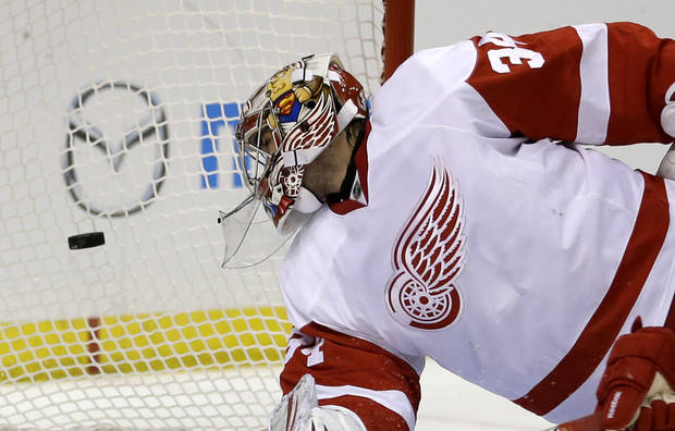 Detroit Red Wings goalie Petr Mrazek, of the Czech Republic, watches as a shot by St. Louis Blues' Alex Pietrangelo slips past for a goal during the second period of an NHL hockey game Thursday, Feb. 7, 2013, in St. Louis. (AP Photo/Jeff Roberson)