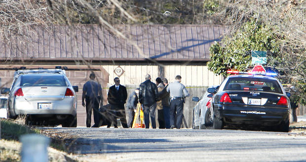 Law enforcement officers investigate after a police officer-involved shooting Tuesday at the corner of N Youngs  Boulevard and Cashion Place in northwest  Oklahoma City.  Photo By  David McDaniel,  The Oklahoman