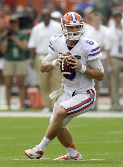Florida quarterback Jeff Driskel drops back as he prepares to pass against Miami during the first half of an NCAA football game, Saturday, Sept. 7, 2013, in Miami Gardens, Fla. (AP Photo/Alan Diaz)