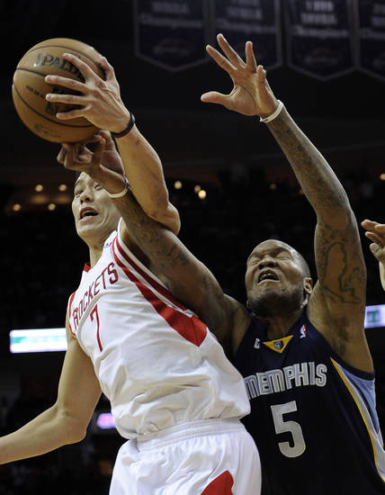 Houston Rockets&#039; Jeremy Lin (7) knocks the ball away from Memphis Grizzlies&#039; Marreese Speights (5) in the first half of an NBA basketball game on Saturday, Dec. 22, 2012, in Houston. (AP Photo/Pat Sullivan)