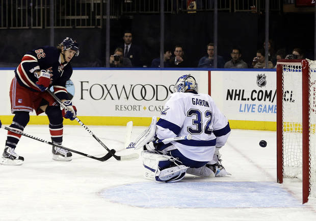 New York Rangers' Carl Hagelin (62) shoots the puck past Tampa Bay Lightning goalie Mathieu Garon (32) to score during the second period of an NHL hockey game, Sunday, Feb. 10, 2013, in New York. (AP Photo/Frank Franklin II)
