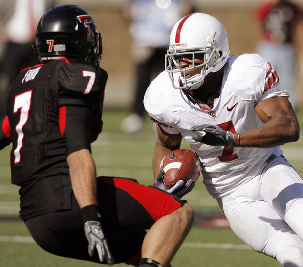 OU's DeMarco Murray (7) tries to get past Will Ford (7) of Texas Tech after Murray was snapped the ball during the college football game between the University of Oklahoma Sooners (OU) and the Texas Tech University Red Raiders (TTU) at Jones AT&T Stadium in Lubbock, Texas, Saturday, Nov. 21, 2009. Photo by Nate Billings, The Oklahoman