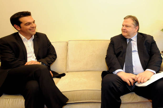 Greek leader of Coalition of the Radical Left party, SYRIZA, Alexis Tsipras, left, and leader of the Socialist Party Evangelos Venizelos smile before their meeting at the Greek Parliament in Athens, Wednesday, May 9, 2012. Greece's commitment to austerity is no longer valid because voters have rejected those deals, the left-wing party leader declared Tuesday as he tried to form a new coalition government. (AP Photo/Evi Fylaktou)