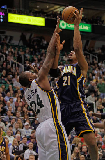 Indiana Pacers forward David West (21) shoots against Utah Jazz forward Paul Millsap (24) in the first half during an NBA basketball game on Saturday, Jan. 26, 2013, in Salt Lake City. (AP Photo/Steve C. Wilson)