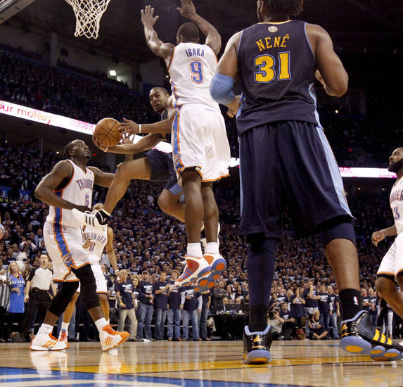 Denver's Arron Afflalo (6) goes between Oklahoma City's Kendrick Perkins (5) and Serge Ibaka (9)during the NBA basketball game between the Denver Nuggets and the Oklahoma City Thunder in the first round of the NBA playoffs at the Oklahoma City Arena, Wednesday, April 27, 2011. Photo by Bryan Terry, The Oklahoman