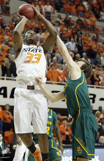 Oklahoma State &#039;s Marcus Smart (33) shoots over Baylor&#039;s Brady Heslip (5) during the college basketball game between the Oklahoma State University Cowboys (OSU) and the Baylor University Bears (BU) at Gallagher-Iba Arena on Wednesday, Feb. 5, 2013, in Stillwater, Okla. Photo by Chris Landsberger, The Oklahoman