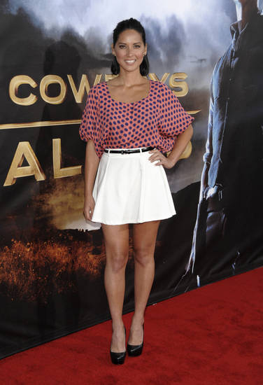 "Television host Olivia Munn arrives at the premiere of the feature film ""Cowboys and Aliens"" at Comic Con in San Diego, Calif. on Saturday, July 23, 2011. (AP Photo/Dan Steinberg) ORG XMIT: CADS119"